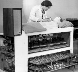 Figure 2: Michael Gordon demonstrating the original Harvey® cardiology simulator. Reused with permission from Cooper JB, Taqueti, VR. A brief history of the development of mannequin simulators for clinical education and training. Postgrad Med J. 2008; 84: 563–570.