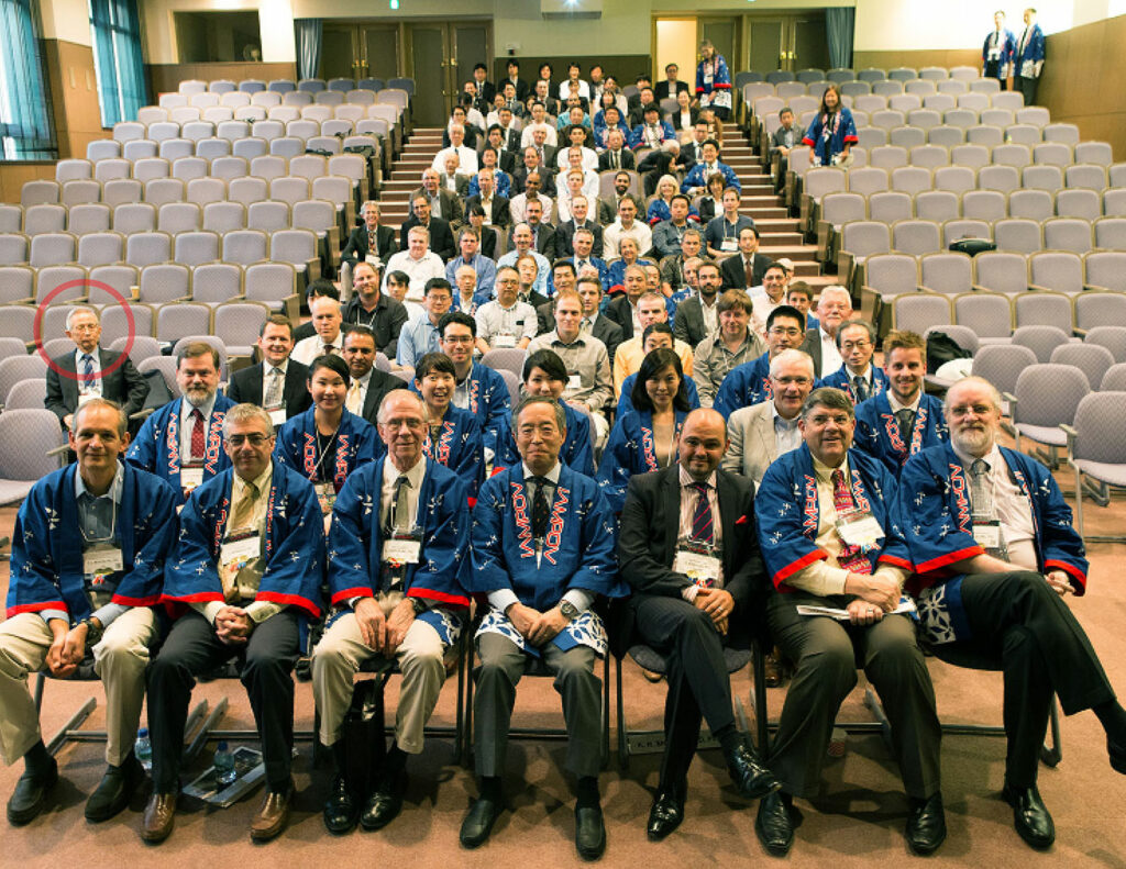 Figure 3: 2015 Tokyo IAMPOV Symposium (Last day, Auditorium at St. Luke's International University)—An international symposium on patient monitoring devices and technology related to circulation, oxygenation, and respiration. Left side in red circle: Takuo Aoyagi. Central area, front row from left to right: P. Bickler (UCSF), S. Weininger (FDA), S. Barker (Masimo) K. Miyasaka (St. Luke's), P. Kyriacou (U. London), B. Kopotic (Edwards), K. Shelley (Yale).