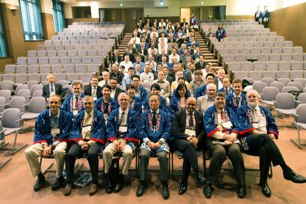 2015 Tokyo IAMPOV Symposium (Last day, Auditorium at St. Luke's International University)<br /> (An international symposium on patient monitoring devices and technology related to circulation, oxygenation, and respiration)<br /> Left side: Dr. Takuo Aoyagi<br /> Central area, front row from left to right:<br /> P. Bickler (UCSF), S. Weininger (FDA), S. Barker (Masimo) K. Miyasaka (St. Luke's)<br /> P. Kyriacou (U. London), B. Kopotic (Edwards), K. Shelley (Yale)