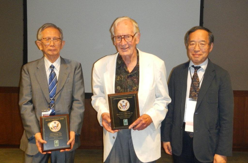 3rd IAMPOV Symposium, 2012, at the award ceremony<br /> From left:<br /> Dr. Takuo Aoyagi, Professor John Severinghaus, Dr. Katsuyuki Miyasaka (the author)